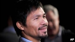 "FILE - Manny Pacquiao at a press conference in New York City. Pacquiao has lost a lucrative contract with U.S. sportswear maker Nike, after describing gays and lesbians as ""worse than animals."""