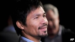 FILE - Manny Pacquiao at a press conference in New York City.