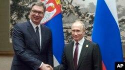 Predsednici Rusije i Srbije Vladimir Putin i Aleksandar Vučić na sastanku u Pekingu, (Foto: AP/Sergei Ilnitsky)