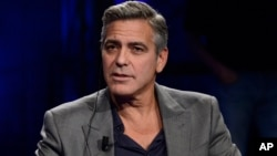 "FILE - George Clooney is interviewed on the Italian State RAI TV program ""Che Tempo che Fa,"" in Milan, Italy, Feb. 9, 2014."