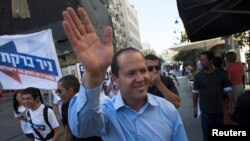 Jerusalem Mayor Nir Barkat waves as he campaigns for mayoral elections in Jerusalem, Oct. 22, 2013.