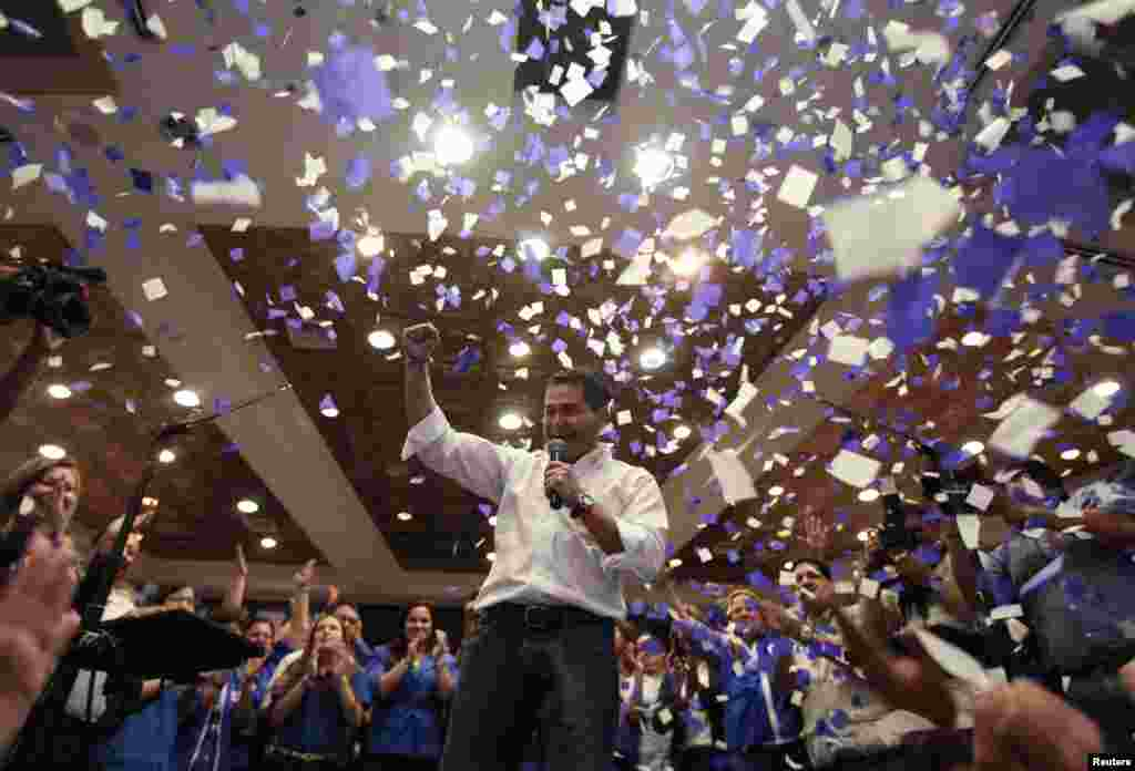 Juan Hernandez, presidential candidate for the ruling National Party, addresses supporters in Tegucigalpa, Honduras, Nov. 24, 2013.