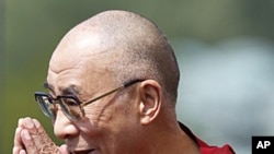 The Dalai Lama arrives at the World Peace Event on the west lawn of the US Capitol in Washington, July 9, 2011