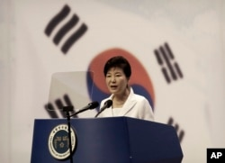 FILE - South Korean President Park Geun-hye delivers a speech during a ceremony to celebrate Korean Liberation Day from Japanese colonial rule in 1945, at Seong Cultural Center in Seoul, South Korea, Aug. 15, 2015.