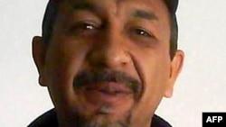"""FILE - This hand out photo shows Servando Gomez Martinez, aka """"La Tuta"""" in Mexico City in June 2009."""