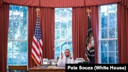 President Barack Obama talks on the phone with Cuba President Raúl Castro in the Oval Office, Sept. 18, 2015.