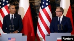 U.S. President Barack Obama addresses during a joint press conference with Poland's President Bronislaw Komorowski (R) at Belveder Palace in Warsaw, June 3, 2014.