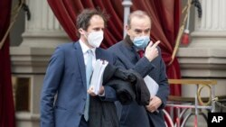 Deputy Secretary General and Political Director of the European External Action Service (EEAS), Enrique Mora, right, leaves the Grand Hotel Wien where closed-door nuclear talks with Iran take place in Vienna, Austria, Tuesday, April 6, 2021. (AP Photo)