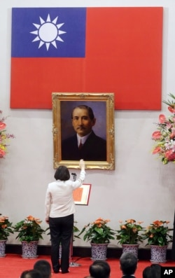 Standing in front of a portrait of the founding father of the Republic of China, R.O.C., Dr. Sun Yat-sen, Taiwan's President Tsai Ing-wen recites the oath of office during the swearing-in ceremony at the Presidential Office in Taipei, Taiwan May 20, 2016.