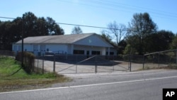 FILE - The building that once housed Superbike Motorsports sits empty in Chesnee, S.C. The building has been abandoned since four people who worked in the shop were shot to death in November 2003. Officials say the man arrested after they found a woman chained on his property killed four people and three other bodies were found on his property.