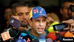 FILE - Venezuela's opposition leader Henrique Capriles speaks to the media in Caracas, Oct. 15, 2017.