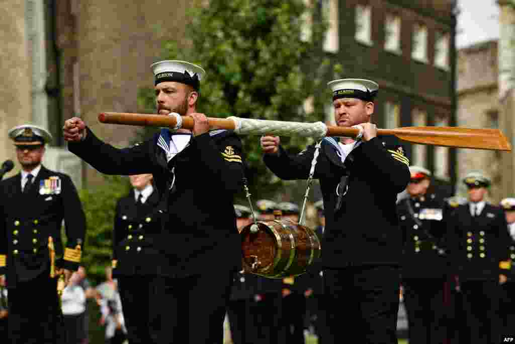 Crew of Britain's HMS Albion carry a keg of wine to the Tower of London during the Constable's Dues ceremony in London.The Constable's Dues ceremony dates back to the fourteenth century when ships travelling up stream to the city were required to moor at Tower Wharf to unload a portion of cargo for the constables as a form of toll.