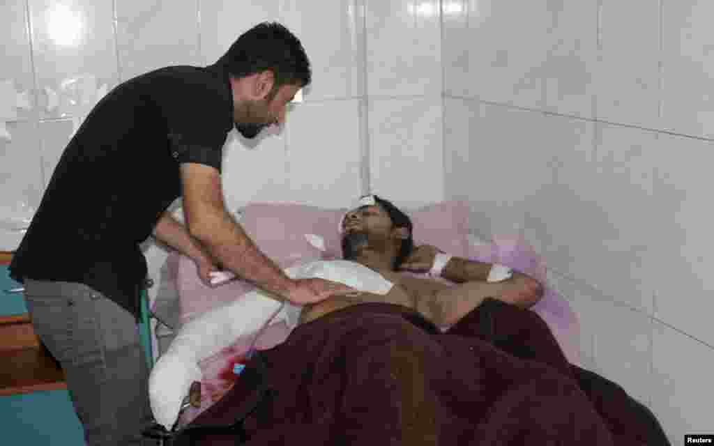 A man rests in a hospital bed after being wounded during a suicide bombing attack in Baquba, about 50 kilometers northeast of Baghdad, July 2, 2013.