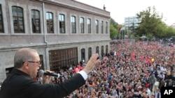 Turkey's President Recep Tayyip Erdogan addresses his supporters in Black Sea city of Trabzon, Turkey, Sunday, Aug. 12, 2018.