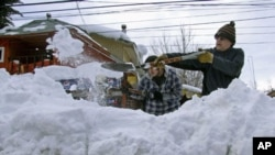 Residents clear snow in Lonquimay, Araucania Region, located 730 kilometers south of Santiago, Chile, July 20, 2011