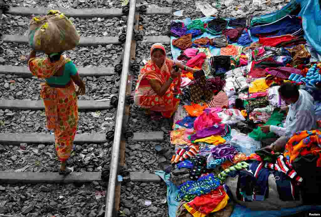A woman shops beside a railway track in Kolkata, India.