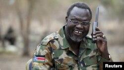 FILE - South Sudan's rebel leader Riek Machar talks on the phone in his field office in a rebel-controlled territory in Jonglei State, South Sudan, Feb. 1, 2014.