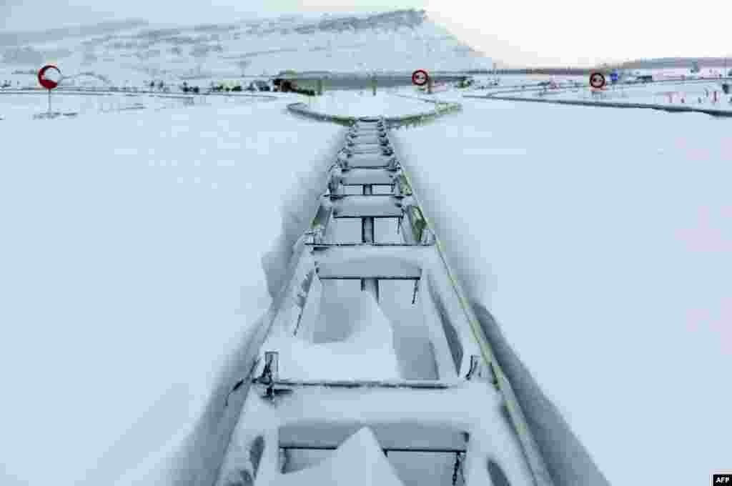 "Guard rails on the highway ""Autovia A-67"" after a heavy snow fall near Aguilar de Campoo, Spain"