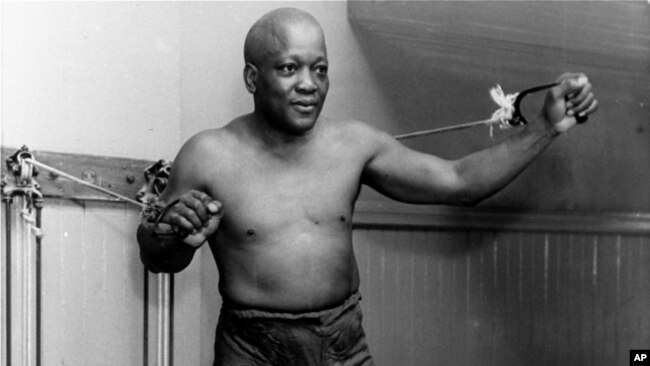 FILE - In this 1932 file photo, boxer Jack Johnson, the first black world heavyweight champion, poses in New York City.