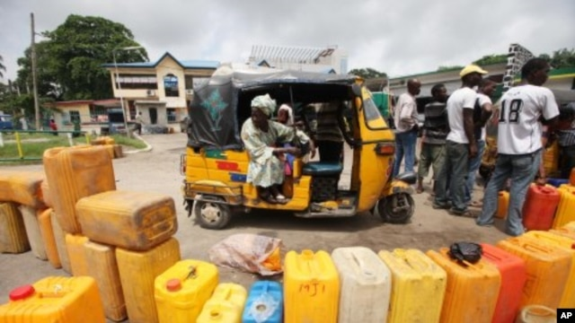 People wait buy kerosene at a petrol station in Lagos, Nigeria, July 4, 2011.