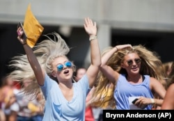 Sorority girls run after in excitement after receiving their sorority's bid for recruitment during the University of Alabama Bid Day, Saturday, August 19, 2017, in Tuscaloosa, Alabama.