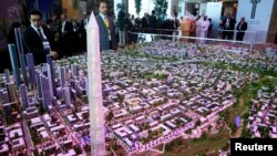 FILE - A model of a planned new capital for Egypt is displayed for investors at the opening of the Egypt Economic Development Conference (EEDC) in Sharm el-Sheikh, in the South Sinai governorate, about 550 km (342 miles) south of Cairo, March 13, 2015.
