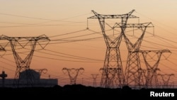 Electricity pylons carrying power for businesses and households.