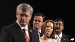 Country leaders from left, Canadian PM Stephen Harper, British PM David Cameron, Australian PM Julia Gillard, and Pakistani PM Yousuf Raza Gilani at the Commonwealth Heads of Government Meeting (CHOGM) in Perth, Australia, October 29, 2011.