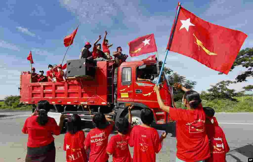Supporters of Myanmar leader Aung San Suu Kyi's National League for Democracy (NLD) party waves the party flag and cheers from a truck during an election campaign in Naypyitaw for next month's general election.