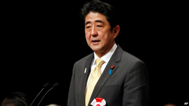 Japanese Prime Minister Shinzo Abe delivers his speech during a national rally marking the Northern Territories Day in Tokyo, Feb. 7, 2013.