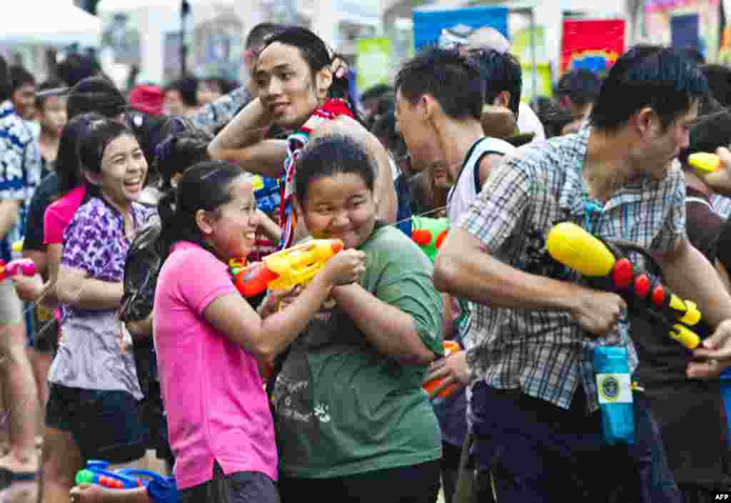 April 13: Thais have a water gun battle in an attempt to set a world record for water splashing during Thai New Year celebrations in Bangkok. The annual New Year celebrations, which takes over most Thai cities and villages, last for three days. (AP Phot