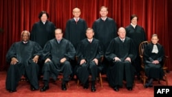 FILE - Justices of the U.S. Supreme Court sit for their official photograph in Washington, Oct. 8, 2010.