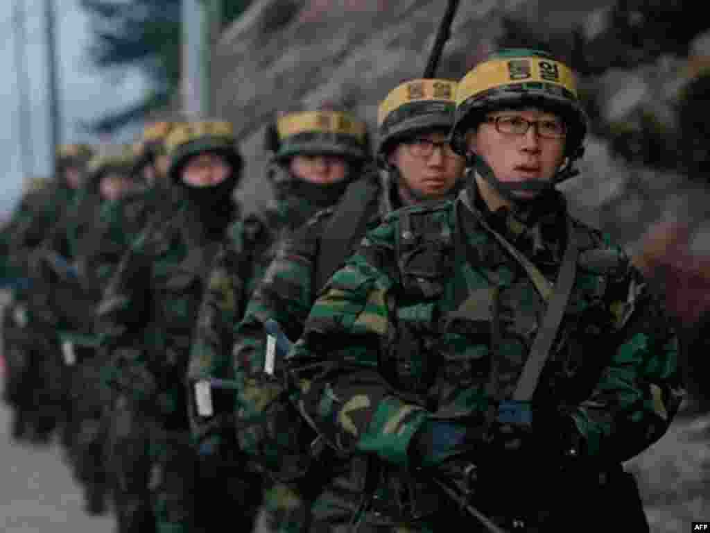 South Korean marines patrol on Yeonpyeong island, South Korea, Sunday, Dec. 19, 2010. Military maneuvers planned by South Korean troops did not take place Saturday because of bad weather on the border island shelled by North Korea last month, but the U.N.