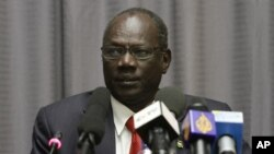 FILE - South Sudan Information Minister Michael Makuei is seen at a press conference in Addis Ababa, Ethiopia, Jan. 5, 2014.