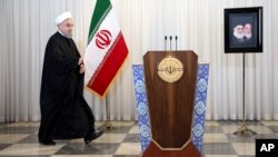 FILE - Iran's president, Hassan Rouhani, arrives for an address to the nation, at his office in Tehran, Iran, Dec. 16, 2015.