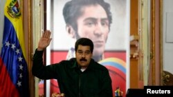 Venezuela's President Nicolas Maduro gestures during a meeting with the opposition's newly elected mayors and governors at Miraflores Palace in Caracas, Dec. 18, 2013.