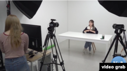 Kang Nara prepares to film a YouTube video from her Seoul studio (video screengrab via VOA News)