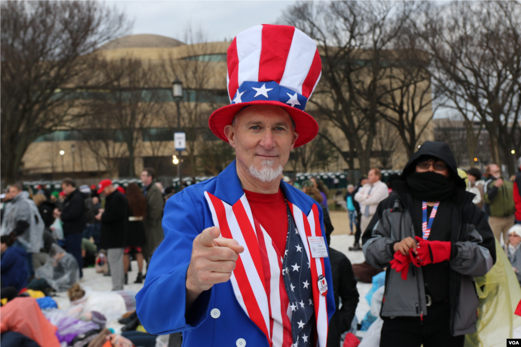 "A Trump supporter dressed as ""Uncle Sam"" in head-to-toe red, white and blue awaits Donald Trump's inauguration as the 45th president of the United States, Jan. 20, 2017. (Photo: B. Allen / VOA)"