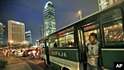 A crew stands at the door of a public bus during rush hour at the main business district in Jakarta, Indonesia (file photo)