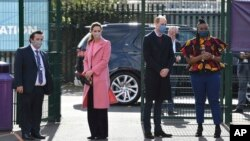 Britain's Prince William with Kate, Duchess of Cambridge visits a secondary school in east London, March 11, 2021 where he defended Britain's monarchy against accusations of bigotry made by his brother, Prince Harry, and his sister-in-law, Meghan.