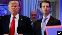 FILE - former President Donald Trump, left, his chief financial officer Allen Weisselberg, center, and son Donald Jr.