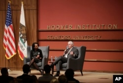 Secretary of State Rex Tillerson, right, and former Secretary of State Condoleeza Rice speak to the Hoover Institution at Stanford University in Stanford, Calif., Jan. 17, 2018.
