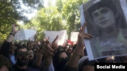 Tehran University students gathered on May 13, 2019, to protest heightened enforcement of mandatory veiling for women during Ramadan and to highlight other concerns such as the May 1, 2019, arrest of journalist Marzieh Amiri, seen pictured on the right.
