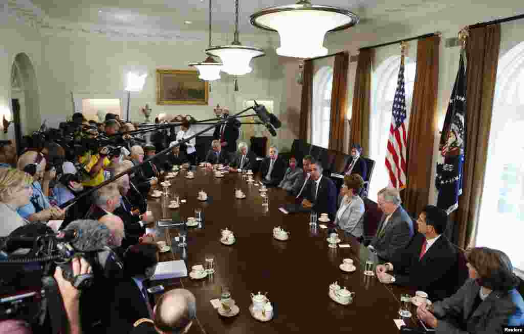 U.S. President Barack Obama (5th R) discusses a military response to Syria at a meeting with bipartisan Congressional leaders in the Cabinet Room at the White House in Washington, D.C.
