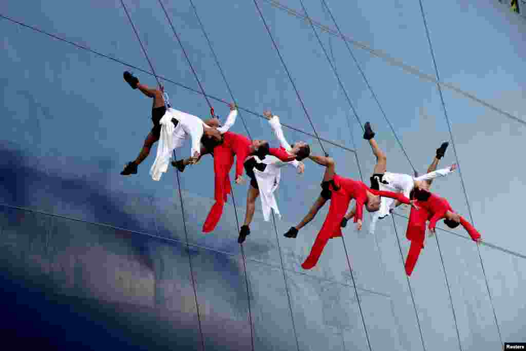 A group of dancers performs during the official inauguration of the CMA CGM Antoine de Saint Exupery container ship in Le Havre, France.