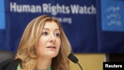 Human Rights Watch (HRW) Middle East director Sarah Leah Whitson, talks during a news conference in Doha June 12, 2012. REUTERS/Stringer (QATAR - Tags: SOCIETY POLITICS)
