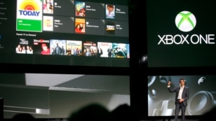 Yusuf Mehdi, senior vice president of Microsoft's Interactive Entertainment Business, discusses the Xbox One uses for television viewing during a press event in Redmond, Washington, May 21, 2013.