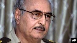 FILE - Libyan ex-General Khalifa Haftar addresses a press conference in Benghazi, Libya, May 17, 2014.