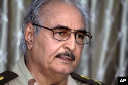 Libyan Gen. Khalifa Haftar addresses a press conference in Benghazi, Libya, May 17, 2014.