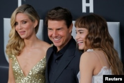 "Actor Tom Cruise arrives with Annabelle Wallis, left, and Sofia Boutella for the premiere of the film ""The Mummy"" in New York, June 6, 2017."